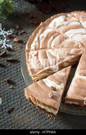 Chocolate ice cream cake Zebra on dark stone background. Christmas tree and decorations. - Stock Photo
