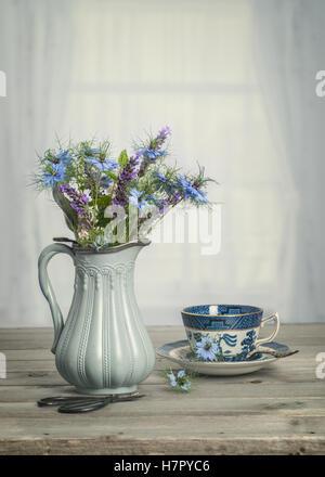 Antique vase of blue cornflowers with vintage tone - Stock Photo