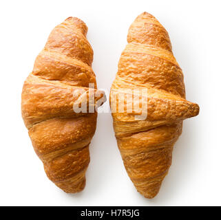 Two tasty buttery croissants isolated on white background. - Stock Photo