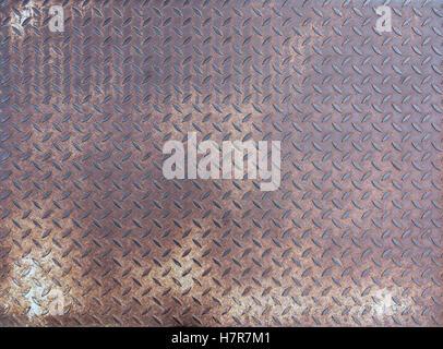 Used diamond rusty steel plate - grunge texture - Stock Photo