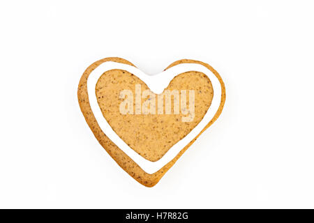holiday ginger cookies with frosting isolated on white. - Stock Photo