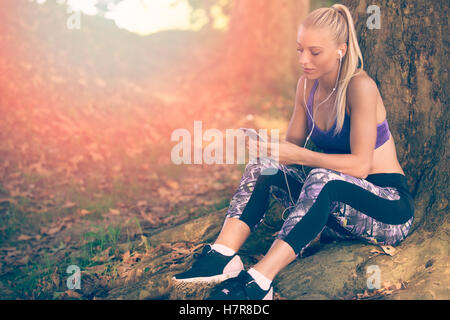Breathing deep during jogging in the forest - Stock Photo