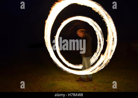 Spinning fire poi - Stock Photo