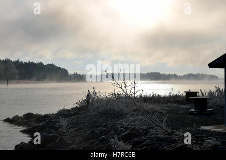 Ice fog rises from the sea on Turku archipelago, Finland. - Stock Photo