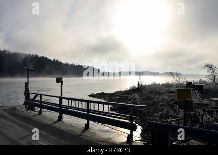 Cold day on November. Mist rises from the sea. - Stock Photo