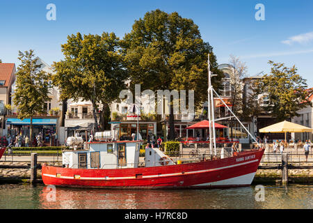 Fishing boat, the Hanno Gunther, Alter Strom Canal, and Am Strom Street, Warnemunde, Germany - Stock Photo