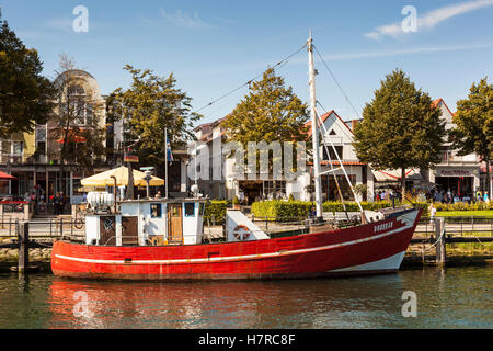 Fishing boat, the Doberan, Alter Strom Canal, and Am Strom Street, Warnemunde, Germany - Stock Photo