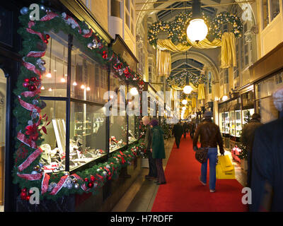 CHRISTMAS SHOPPING SHOPPERS Burlington Arcade in Piccadilly with traditional Christmas decorations and shoppers - Stock Photo