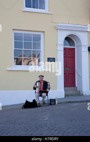 Gentleman playing an accordian near Tenby harbour, Tenby,Pembrokeshire, South Wales,uk - Stock Photo