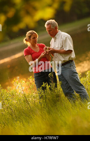 Couple Hiking At Sunset - Stock Photo