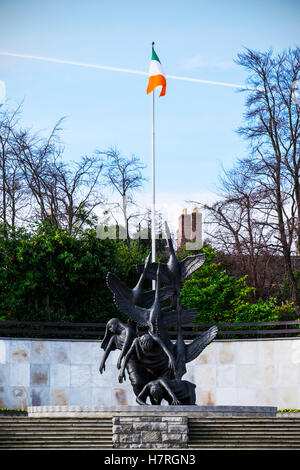 Children of Lir sculpture and the Republic of Ireland flag in the Garden of Rememberance, Parnell Square; Dublin, - Stock Photo
