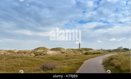 Landscape on German island Norderney situated in the North Sea with a lighthouse on the horizon - Stock Photo