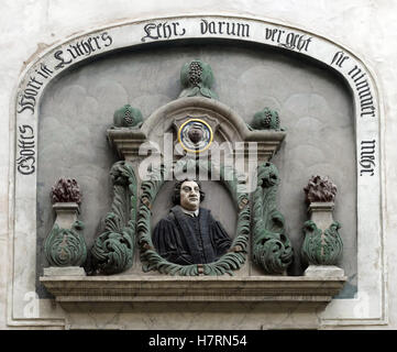 The relief above the entrance of the house in which Martin Luther (1483-1546) was born, photographed in the Luther - Stock Photo