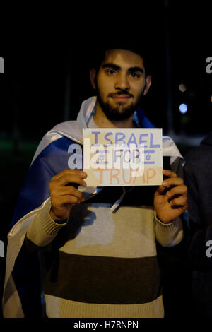 Jerusalem, Israel. 7th Nov, 2016. An Israeli supporter of US presidential candidate Donald Trump holding a sign - Stock Photo