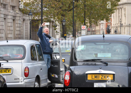 Whitehall, London, UK. 8th November 2016. Black cab drivers stage a protest over UBER and call for a public inquiry - Stock Photo