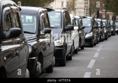 Thousands of London taxi drivers brings Whitehall to a gridlock as they protest in calling for a Public Inquiry - Stock Photo