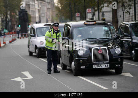 London, England, UK. 8th Nov, 2016. United Cabbies Group bring Whitehall to a standstill to demand a public inquiry - Stock Photo