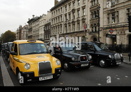 London Cabbies protest against unfair competition from Uber - Stock Photo