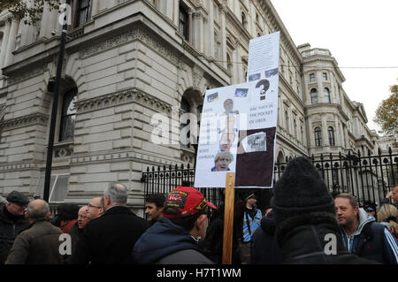 Cabbies brought their protest about Uber to Downing street. The black cab drivers are angry with Transport for London, - Stock Photo