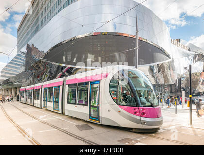 A tram in Birmingham City Centre alongside New Street train station, England. Editorial usage only. - Stock Photo