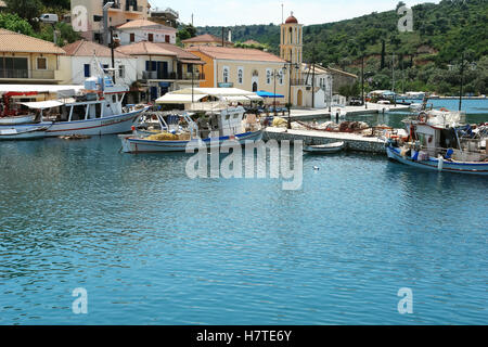 Vathi, GREECE, May 11, 2013: Landscape with church, mooring and fishing-boat in port of Vathi on the Meganisi island. - Stock Photo
