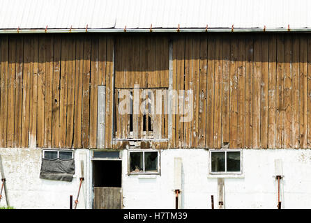 An old wooden barn on an abandoned farm in rural. - Stock Photo