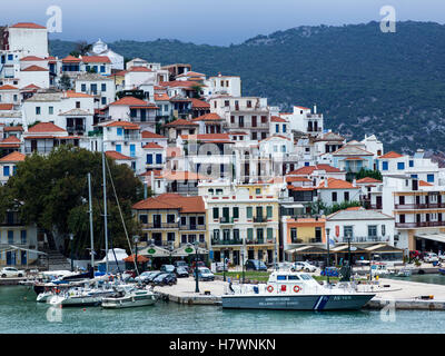 Houses on the hillside and boats in the harbour on a greek island; Skopelos Town, Skiathos, Greece - Stock Photo