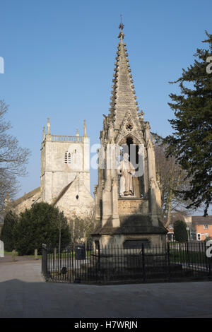 Spring sunshine on St Mary de Lode church and Bishop Hooper's monument in Gloucester - Stock Photo
