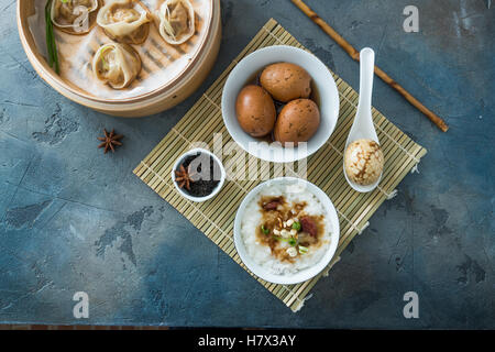 Chinese Streamed Dumpling with tea eggs and porrige - Stock Photo