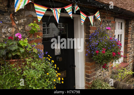 UK, England, Buckinghamshire, West Wycombe, High Street, bunting above door of Community Library - Stock Photo