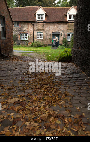 UK, England, Buckinghamshire, West Wycombe, High Street, Crown Court cottages through archway - Stock Photo