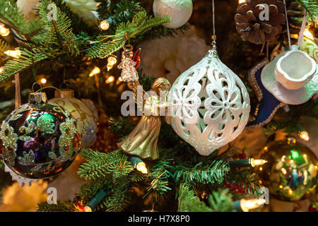 Angel toy decoration. Detailed photo of the Christmas decoration of a golden angel toy in the house. - Stock Photo