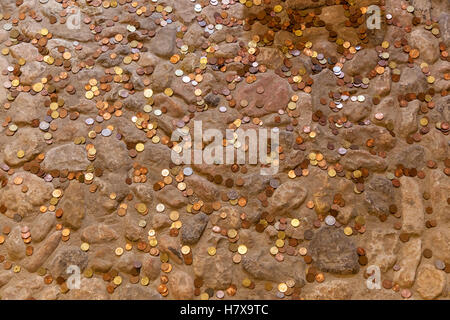 Scattered coins lay on the stone floor,Coins on the floor - Stock Photo
