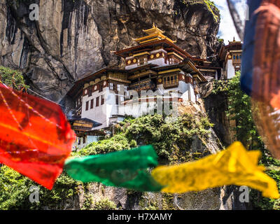 Taktshang Goemba. Tigers nest monastery. view with prayer flags Bhutan - Stock Photo