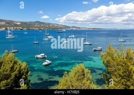 Azure harbor with lots of sailers and cutters rock on the waves transparent. Dangling a massive cloud over the mountains - Stock Photo
