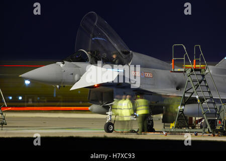 Royal Air Force Eurofighter Typhoon aircraft operating at night at RAF Coningsby in Lincolnshire - Stock Photo