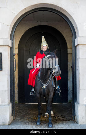 LONDON - OCTOBER 31, 2016: Mounted Queen's Life Guard of the Household Cavalry stands in an archway facing Whitehall. - Stock Photo