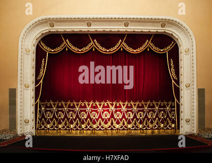 Open red curtains with glitter opera or theater background - Stock Photo