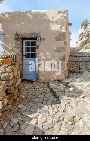 Quaint rural house built from granite in the village of Sant'Antonino, Balagne, Corsica, France - Stock Photo