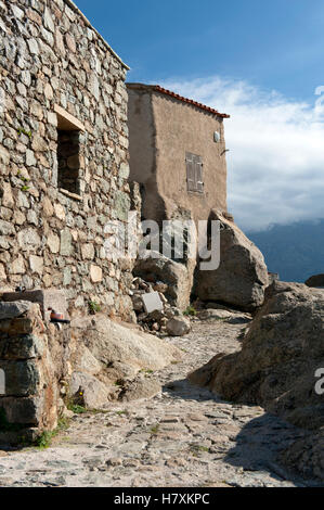 Ancient rural farm house built from granite rock, towering atop the village of Sant'Antonino in Haute-Corse, France - Stock Photo