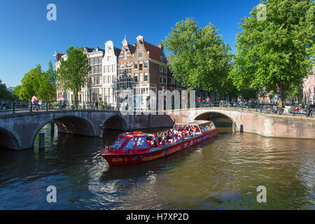 Tourist cruise boat on Prinsengracht canal, Amsterdam, Netherlands - Stock Photo