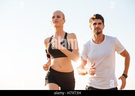Young couple runners training together outdoors - Stock Photo