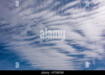 Cirrocumulus cloud in blue sky and fluffy clouds beautiful quaint in daytime - Stock Photo