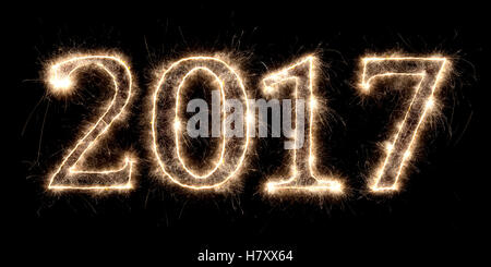 2017 firework sparkler bright glowing new years eve font lettering number date - Stock Photo