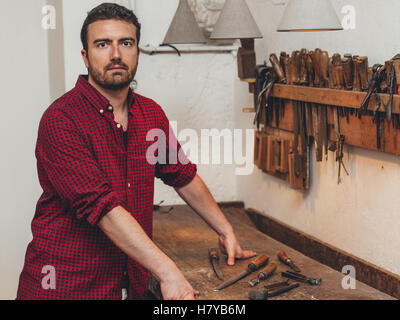 Carpenter working with tools in his carpentry - Stock Photo