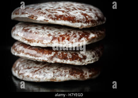 Round Lebkuchen on black background - Stock Photo