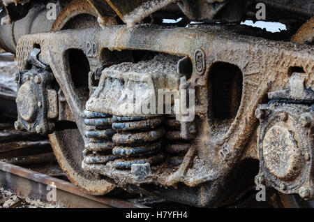 Train rusty wheels covered by salt of Baskunchak lake, Russia. It is stains on railroad carriage's surface . Close - Stock Photo
