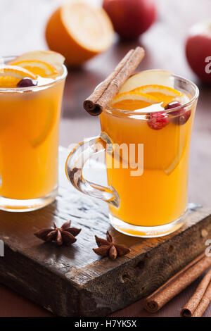 hot apple orange cider with cinnamon spice warming drink - Stock Photo