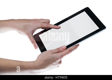 Hands using digital tablet against white background - Stock Photo
