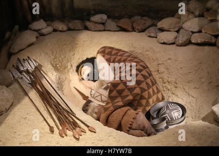 Beaker culture. Recreation of a Beaker grave of a young male at Fuente Olmedo (Valladolid). Burial with grave goods. - Stock Photo